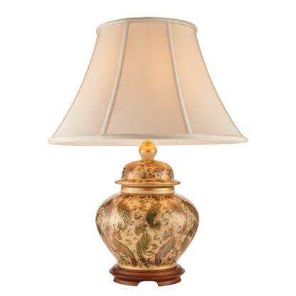 lampa stołowa z ceramiki i drewna zakończona jasnym materiałowym kloszem