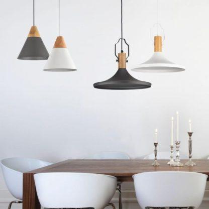 aranżacja lam wiszacych nad stół - czarna, biała, szara z drewnem