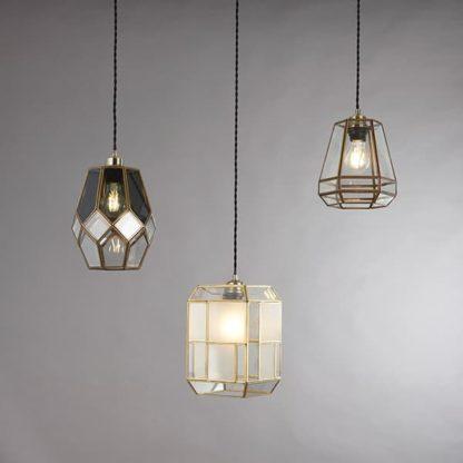 nowoczesna lampa wisząca z kloszem z przezroczystego i matowego szkła