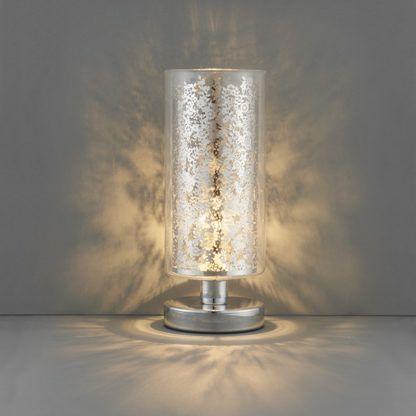 lampa stołowa nowoczesna wykonana z transparentnego szkła i srebrnych detali