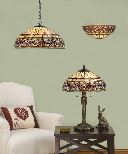 średniej wielkości lampa stołowa ze szkła i metalu